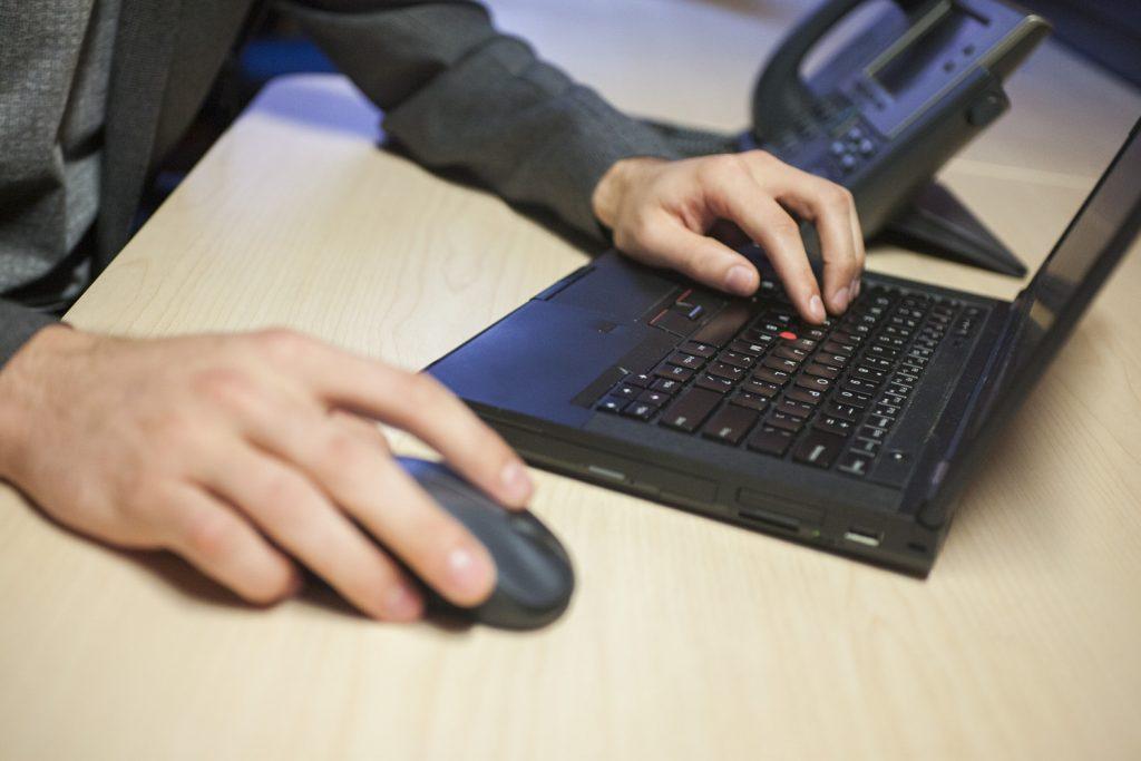 Working Tenant File at Computer